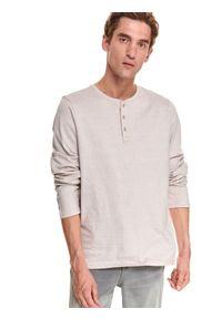 TOP SECRET - T-shirt z wywijanym rękawem. Okazja: na co dzień. Kolor: beżowy. Materiał: bawełna, tkanina. Długość rękawa: długi rękaw. Długość: długie. Sezon: jesień. Styl: casual