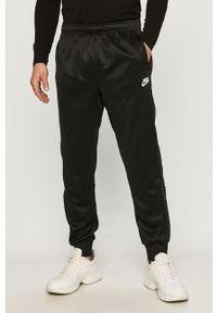 Czarne spodnie dresowe Nike Sportswear z aplikacjami