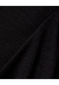 ISABEL MARANT - Czarny golf z wełny Gavina. Typ kołnierza: golf. Kolor: czarny. Materiał: wełna. Długość: długie. Styl: elegancki