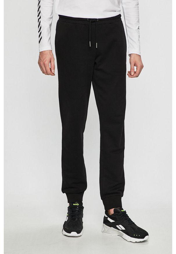 Czarne spodnie dresowe Fila melanż