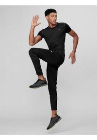 Czarne spodnie sportowe 4f na fitness i siłownię