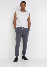 Niebieskie spodnie dresowe Born2be #7