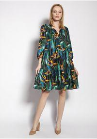 e-margeritka - Sukienka trapezowa koszulowa z falbanami - 34/36. Kolekcja: moda ciążowa. Materiał: tkanina, wiskoza, materiał. Sezon: lato. Typ sukienki: koszulowe, trapezowe
