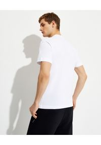 PALM ANGELS - Biała koszulka z logo. Kolor: biały. Materiał: bawełna. Wzór: aplikacja. Styl: klasyczny