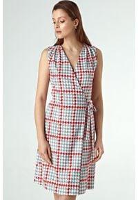 Colett - Elegancka kopertowa sukienka w modną pepitkę. Długość rękawa: krótki rękaw. Typ sukienki: kopertowe. Styl: elegancki