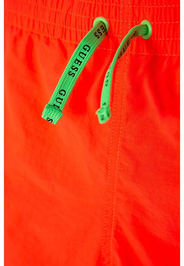 Pomarańczowe kąpielówki Guess Jeans