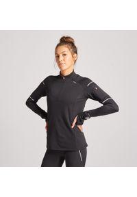 KIPRUN - Koszulka do biegania z długim rękawem damska Kiprun Warm Light cienka ocieplana. Kolor: czarny. Materiał: elastan, poliester, materiał. Długość rękawa: długi rękaw. Długość: długie. Sezon: zima. Sport: fitness